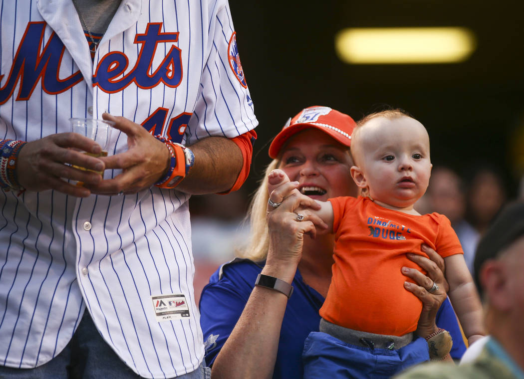 Las Vegas 51s fan Rosette DeGennaro holds up eight-month-old Danny Hughes before the start of the opening day game between the Las Vegas 51s and El Paso Chihuahuas at Cashman Field in Las Vegas on ...