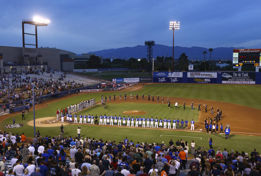 First responders from the Oct. 1 shooting join players from the Las Vegas 51s and El Paso Chihuahuas on the field to form the shape of a heart before the start of the opening day baseball game at  ...