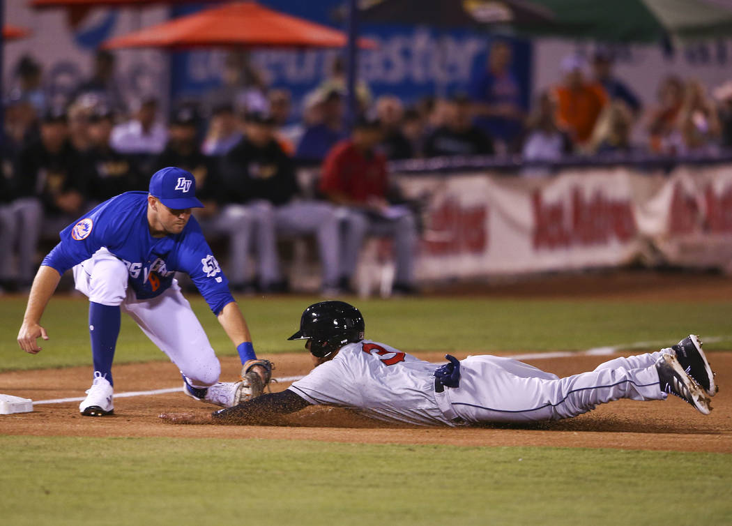 Las Vegas 51s third baseman David Thompson (8) tags out El Paso Chihuahuas shortstop Luis Urias (3) during the opening day baseball game at Cashman Field in Las Vegas on Thursday, April 5, 2018. C ...