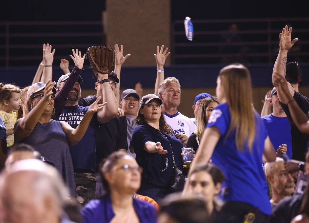 Ice cream bars are passed out to fans in memory of longtime Las Vegas 51s season ticket holder Phyllis Flaherty, who passed away in the offseason, during the opening day baseball game against the  ...