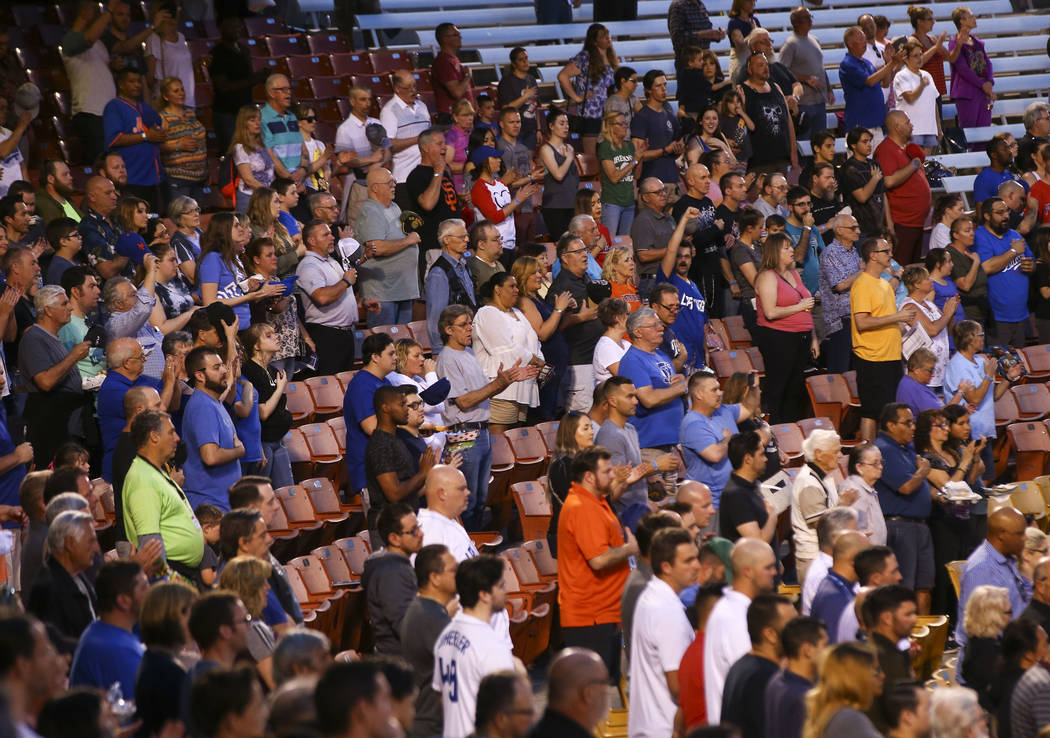 Baseball fans cheer during the opening day game between the Las Vegas 51s and El Paso Chihuahuas at Cashman Field in Las Vegas on Thursday, April 5, 2018. Chase Stevens Las Vegas Review-Journal @c ...