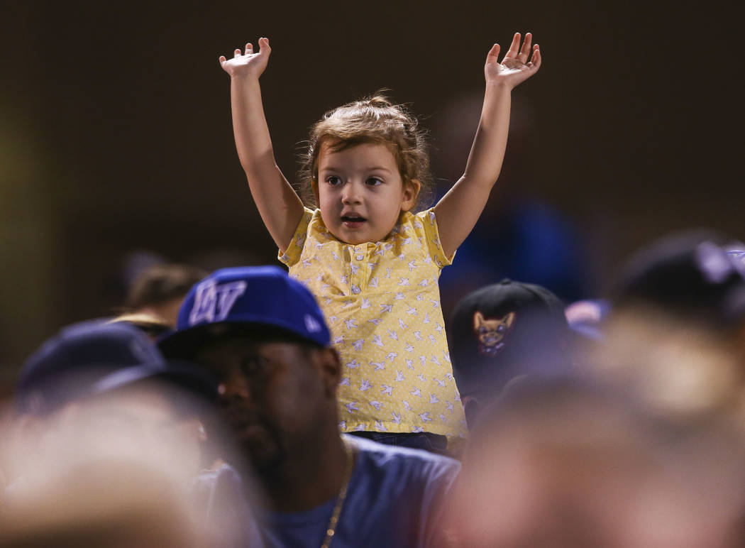 A young Las Vegas 51s fan cheers during the opening day baseball game against the El Paso Chihuahuas  at Cashman Field in Las Vegas on Thursday, April 5, 2018. Chase Stevens Las Vegas Review-Journ ...