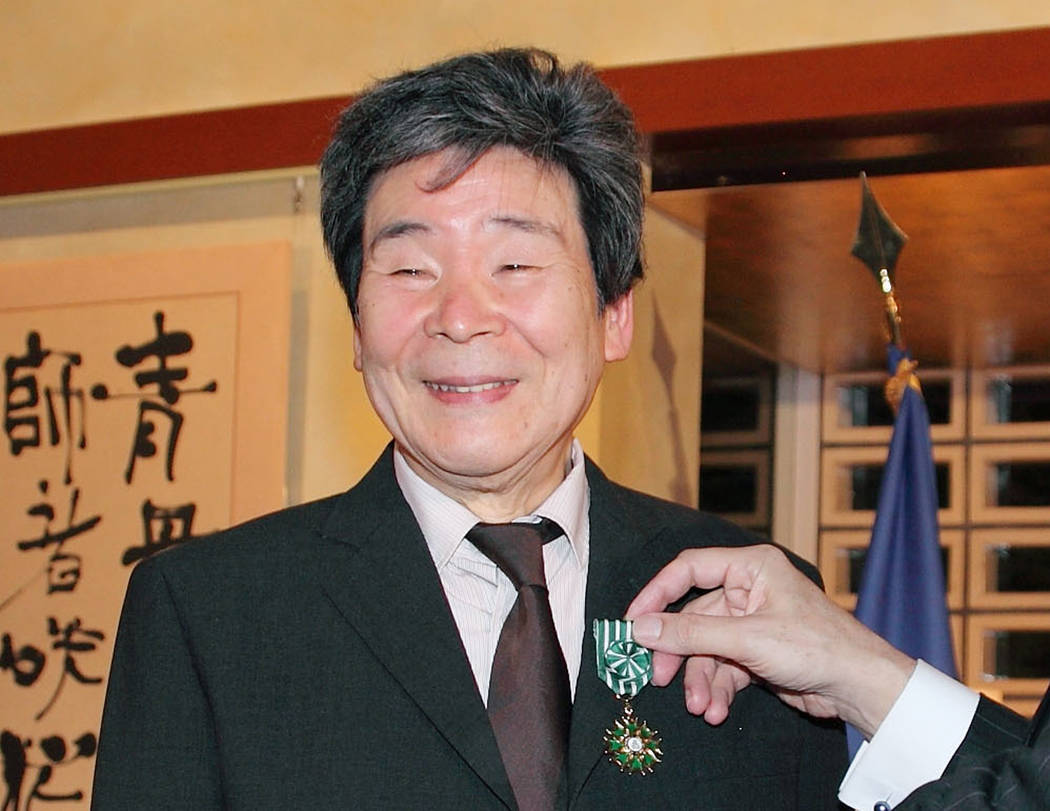 Isao Takahata, co-founder of the prestigious Japanese animator Studio Ghibli, receives Officer of the French Order of Arts and Letters in Tokyo in 2015. (Kyodo News via AP)