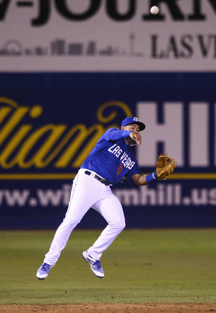Las Vegas 51s shortstop Luis Guillorme (13) throws to first bae during the opening day baseball game against the El Paso Chihuahuas at Cashman Field in Las Vegas on Thursday, April 5, 2018. Chase  ...