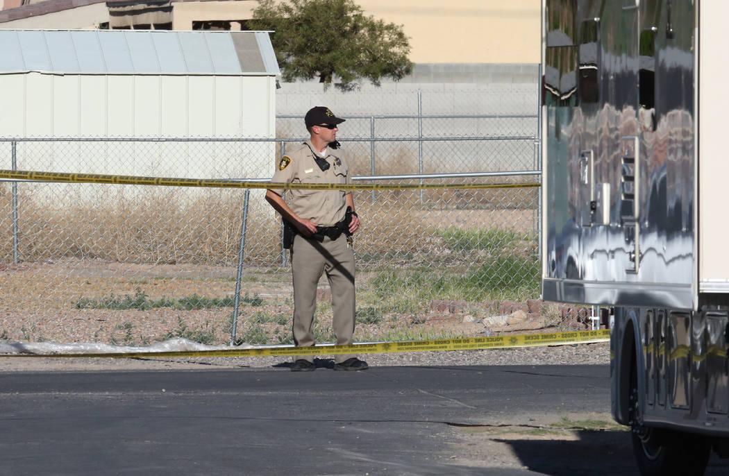 Las Vegas police investigate an officer-involved shooting at Madge Lane and Mabel Road, between Charleston Boulevard and Stewart Avenue, Friday, April 6, 2018, in Las Vegas. Bizuayehu Tesfaye/Las  ...