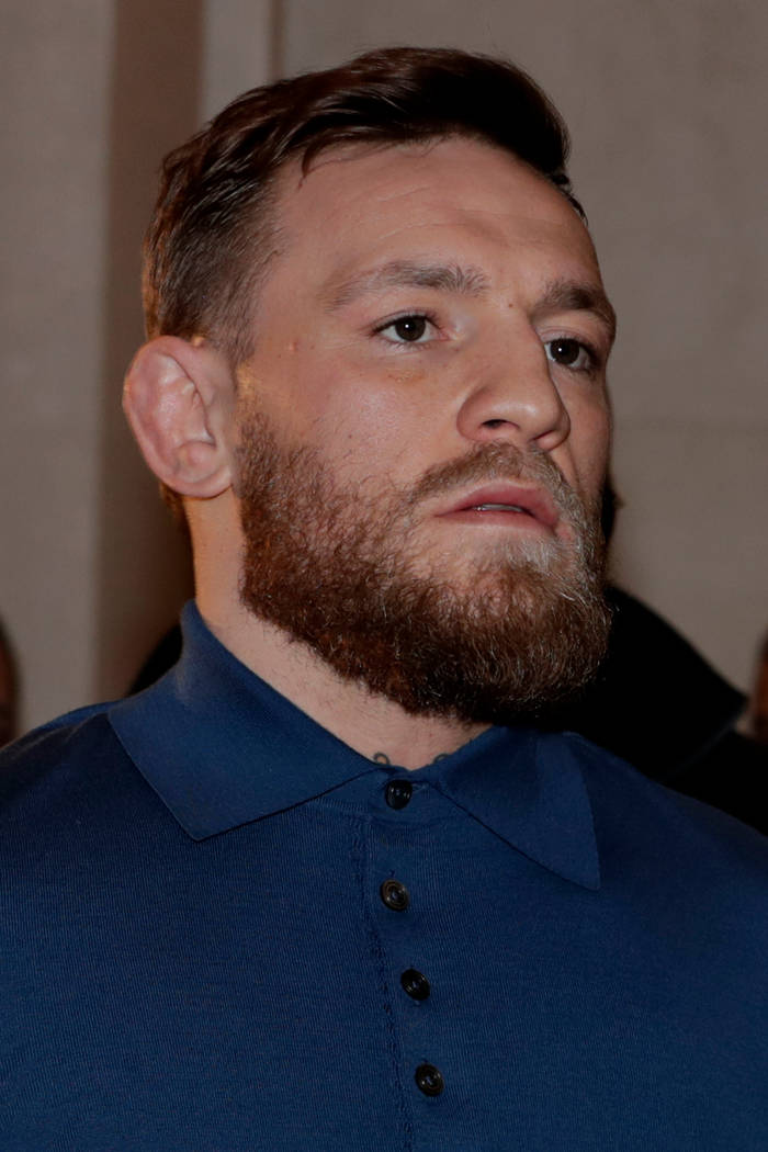 Ultimate fighting star Conor McGregor is escorted by New York Court Police officers after a hearing at the Brooklyn Criminal Court, Friday, April 6, 2018, in the Brooklyn borough of New York. McGr ...