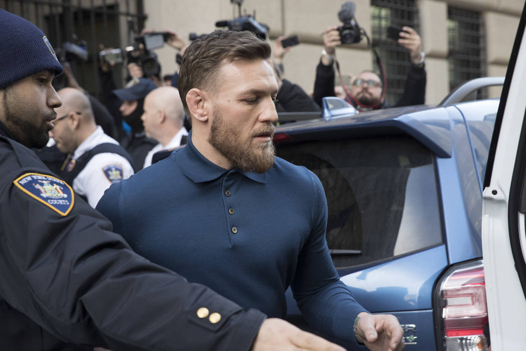 Ultimate fighting star Conor McGregor heads to a vehicle to leave Brooklyn Criminal Court, Friday, April 6, 2018 in New York. McGregor is facing criminal charges in the wake of a backstage melee h ...
