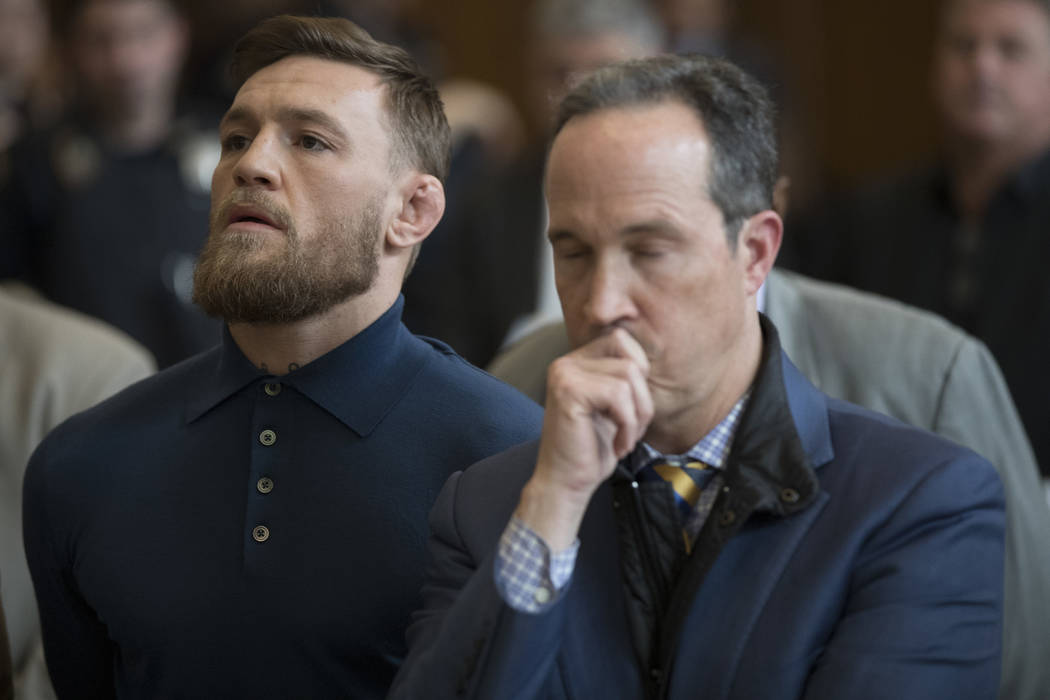 CORRECTS TO BROOKLYN CRIMINAL COURT, NOT BROOKLYN FEDERAL COURT-Ultimate fighting star Conor McGregor, left, stands with his lawyer Jim Walden during his arraignment in Brooklyn Criminal Court, Fr ...