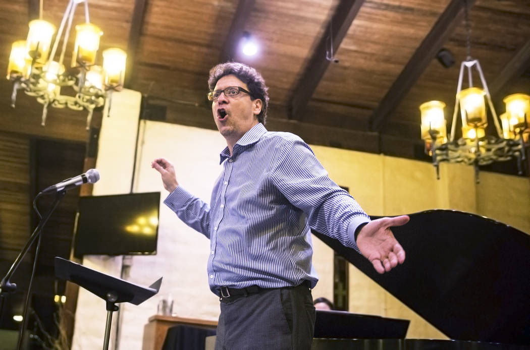 Donato Cabrera, music director of the Las Vegas Philharmonic Orchestra, conducts rehearsal for an April 1 concert featuring Brahms' German Requiem by the Las Vegas Philharmonic and Las Vegas Maste ...