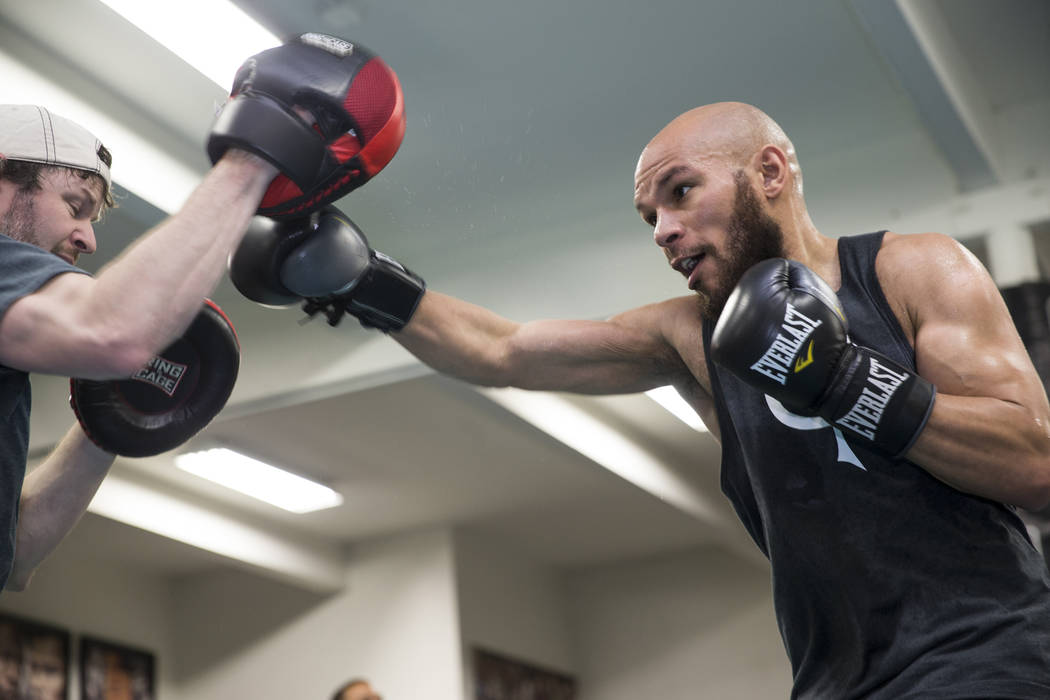 Boxer Caleb Truax, right, with her trainer Tom Halstad during media day at the Mayweather Boxing Club in Las Vegas, Wednesday, April 4, 2018.ErikVerduzcoLasVegasRevie ...