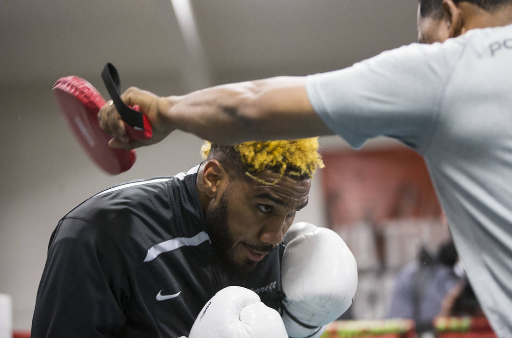 Boxer Jarrett Hurd, left, with his trainer Ernesto Rodriguez, during media day at the Mayweather Boxing Club in Las Vegas, Wednesday, April 4, 2018.  Erik Verduzco Las Vegas Review-Journal @Erik_V ...