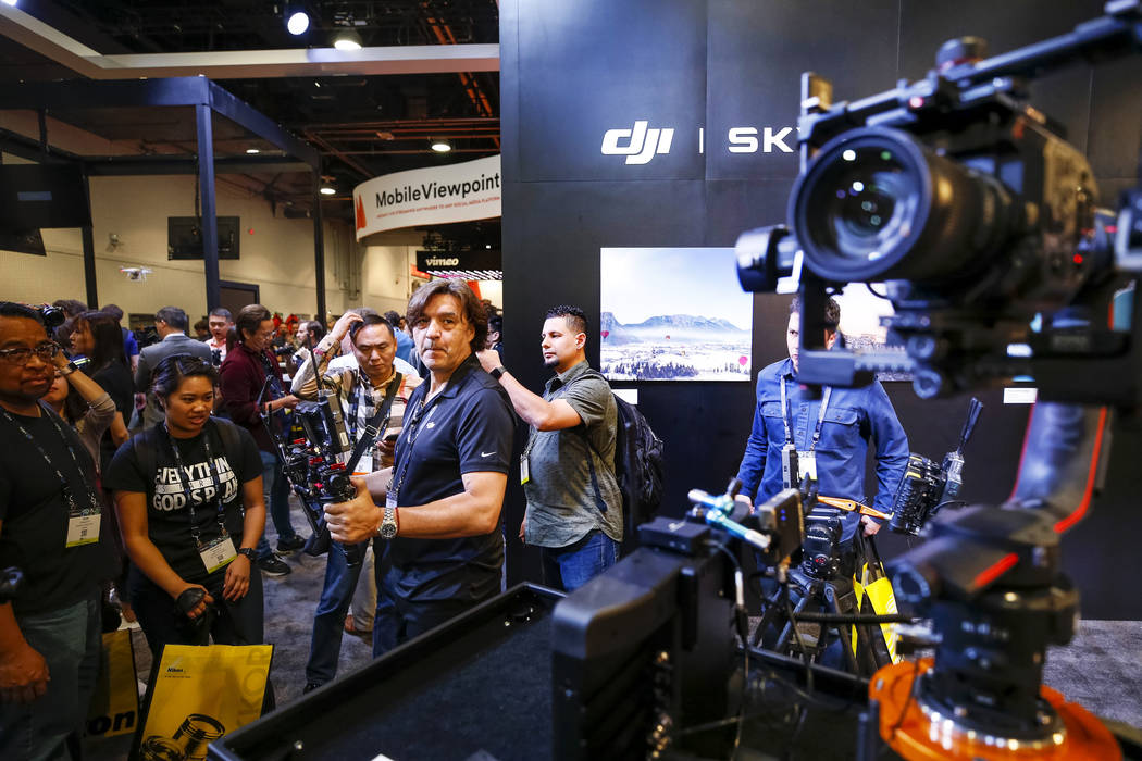 DJI's Christian Calderon demos the DJI Force Pro, a  movement control system that allows cameras to be operated remotely, the NAB Show at the Las Vegas Convention Center on Monday, April 9, 2018.  ...
