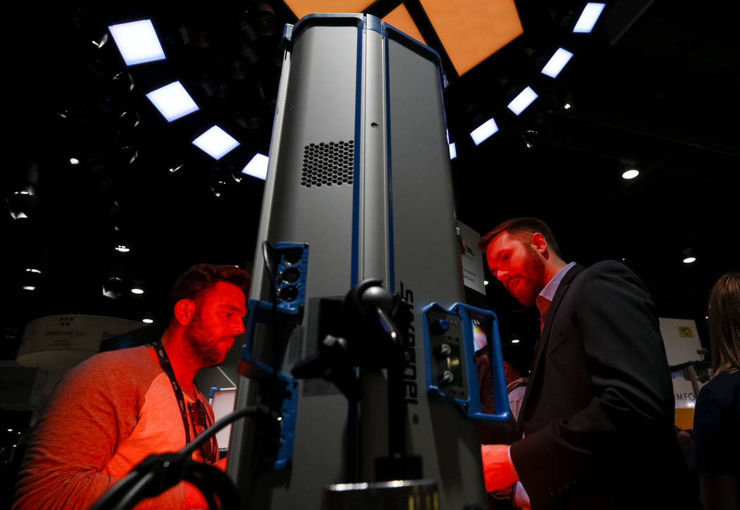Show attendees browse at a SkyPanel S-120 LED light on display at the ARRI booth during the NAB Show at the Las Vegas Convention Center, Monday, April 9, 2018. Richard Brian Las Vegas Review-Journ ...
