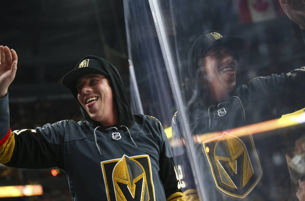 A fan celebrates a goal by Golden Knights center Oscar Lindberg, not pictured, during the second period of an NHL hockey game against the San Jose Sharks at T-Mobile Arena in Las Vegas on Saturday ...