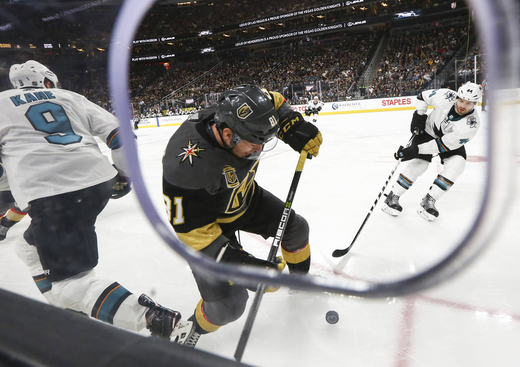 Golden Knights center Jonathan Marchessault (81) looks to move the puck past San Jose Sharks defenseman Marc-Edouard Vlasic (44) during the second period of an NHL hockey game at T-Mobile Arena in ...