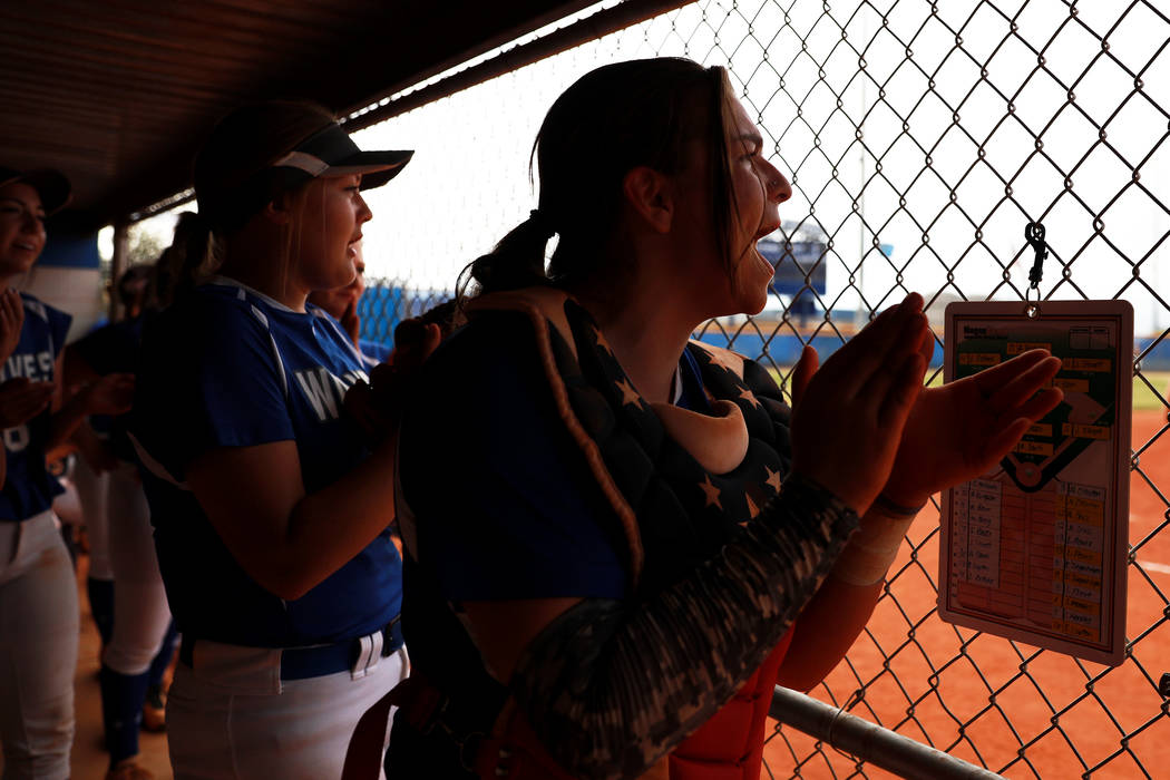 The Basic varsity softball team cheers on a teammate while up to bat against Coronado during the third inning at Basic High School in Henderson on Friday, April 6, 2018. Basic won 4-3. Andrea Corn ...