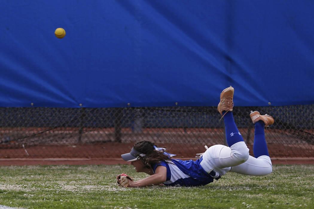 Basic's centerfielder Lauren Koshak (4) dives for a fly ball against Coronado during the fourth inning at Basic High School in Henderson on Friday, April 6, 2018. Basic won 4-3. Andrea Cornejo Las ...