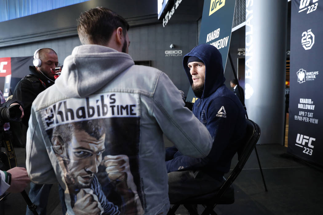Khabib Nurmagomedov, right, answers questions during a media availability, Thursday, April 5, 2018, at the Barclay's Center in New York. The UFC 223 Mixed Martial Arts main event, Khabib Nurmagome ...