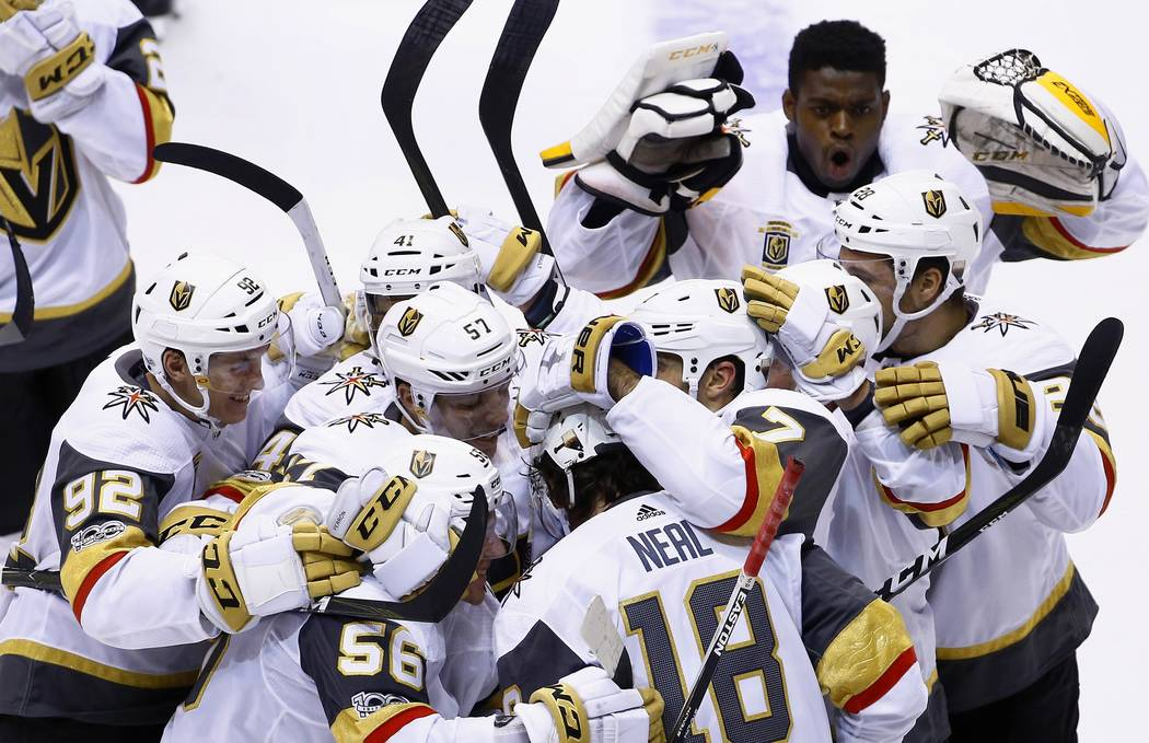 Vegas Golden Knights left wing James Neal (18) celebrates his game-winning goal against the Arizona Coyotes with Golden Knights left wing Tomas Nosek (92), left wing David Perron (57), left wing E ...