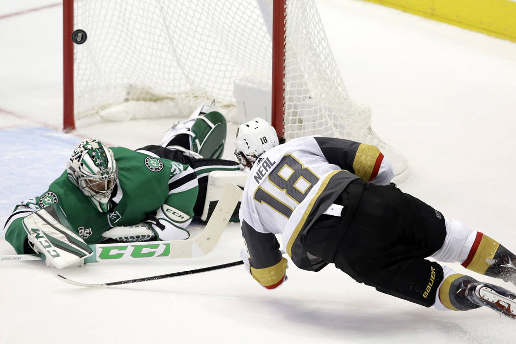 In this Friday, Oct. 6, 2017, file photo, Vegas Golden Knights left wing James Neal (18) scores a goal against Dallas Stars goalie Kari Lehtonen (32) during the third period of an NHL hockey game  ...