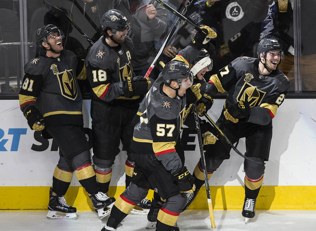 Golden Knights Jonathan Marchessault (81), James Neal (18), David Perron (57) and Shea Theodore (27) celebrate after Theodore scored the go-ahead goal in the third period during Vegas' home matchu ...