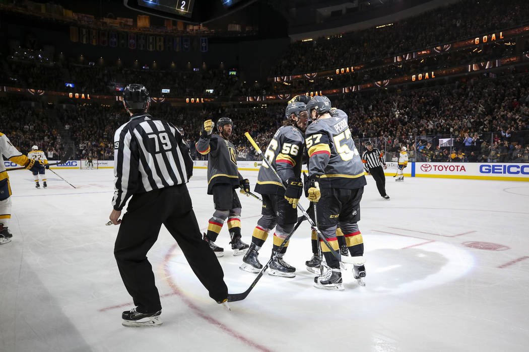 Vegas Golden Knights Erik Haula (56) and David Perron (57) celebrate a third period goal by Jonathan Marchessault during an NHL hockey game against the Nashville Predators at the T-Mobile Arena in ...