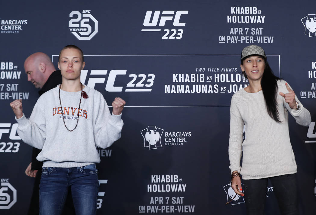 UFC women's straw weight champion Rose Namajunas, left, poses for a photograph with upcoming opponent Joanna Jedrzejczyk, Thursday, April 5, 2018, during UFC 223's media day at the Barclay's Cente ...