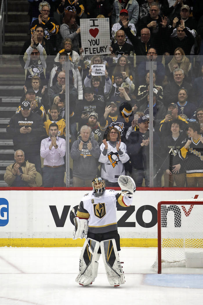 Vegas Golden Knights goaltender Marc-Andre Fleury (29) waves to the crowd after a video tribute to his winning three Stanley Cups with the Pittsburgh Penguins during the first period of an NHL hoc ...