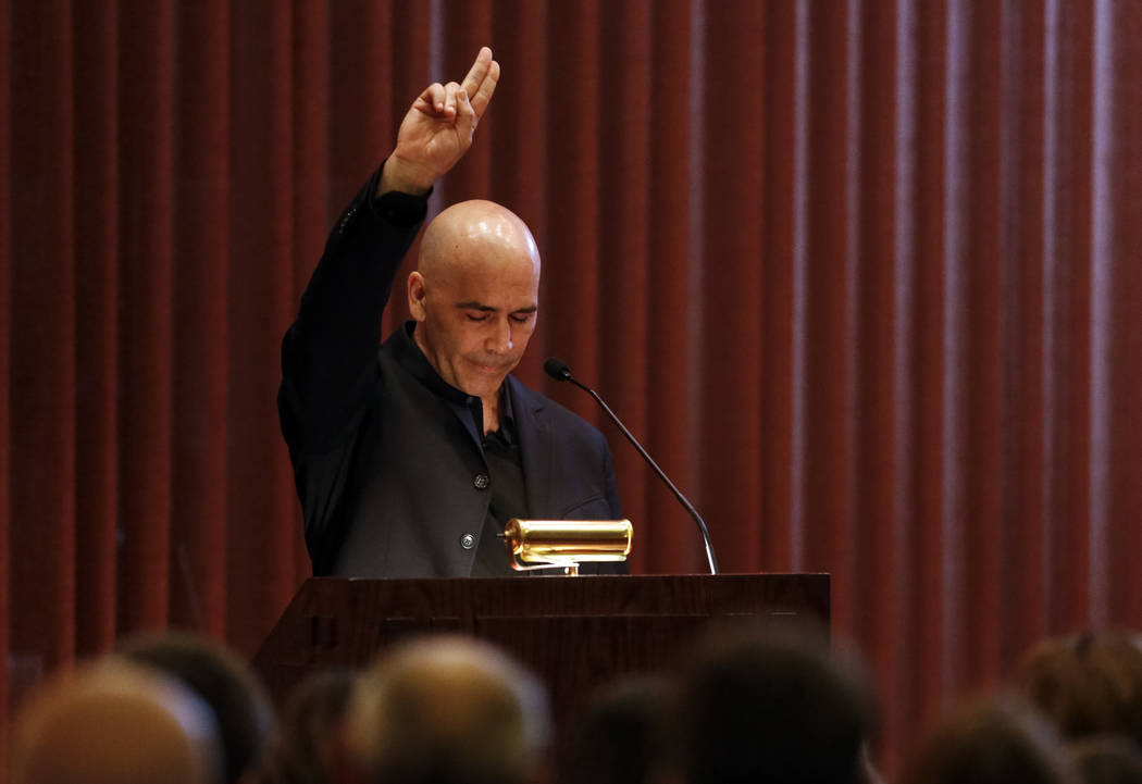 Eric Oram, son of Kent Oram, points to the sky after speaking at his fathers celebration of life ceremony at Palm Mortuary in Las Vegas on Saturday, April 7, 2018. The longtime Nevada campaign man ...