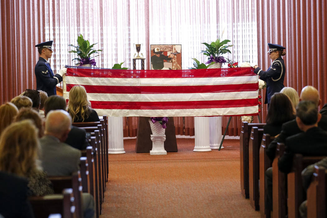 An Honor Guard fold an American flag during the celebration of life ceremony for Kent Oram at Palm Mortuary in Las Vegas on Saturday, April 7, 2018. The longtime Nevada campaign manager Kent Oram, ...