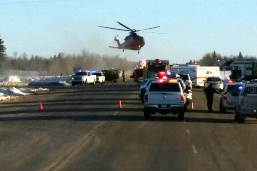 This image provided by 650 CKOM/980 CJME shows emergency crews responding to the scene where a bus carrying a junior hockey team to a playoff game was struck by a semi Friday, April 6, 2018, north ...