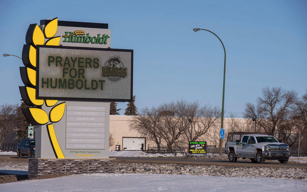 A truck drives by the welcome sign honoring the members of the Humboldt Broncos hockey team in Humboldt, Saskatchewan, Canada,  Saturday, April 7, 2018. Canadian police said early Saturday that se ...