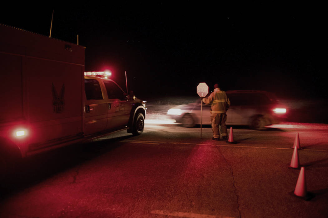 Emergency crews continue to block the highway on Saturday, April 7, 2018, near the area where a bus carrying a junior hockey team to a playoff game was struck by a semi Friday, north of Tisdale, S ...