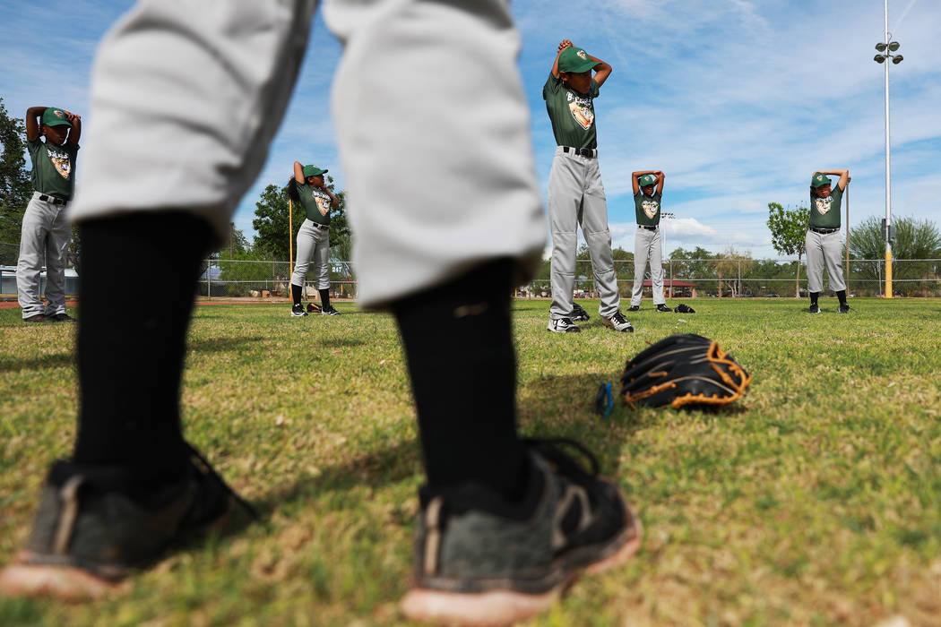 Marios West Side Bulldogs warm up before playing against the Las Vegas Fire Department Engine 106 Red Soxduring the Bolden Little League's Opening Day at Doolittle Field in Las Vegas on Satu ...