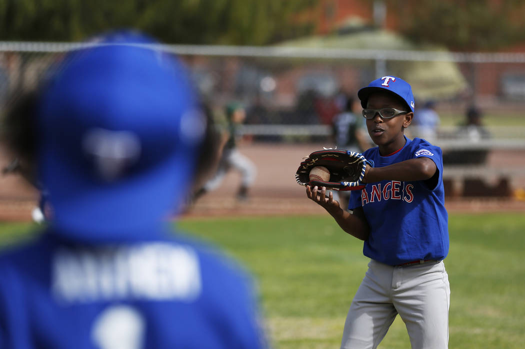 Rangers' James McCall, 11, practices with his team during the Bolden Little League's Opening Day at Doolittle Field in Las Vegas on Saturday, April 7, 2018. Andrea Cornejo Las Vegas Review-Journal ...