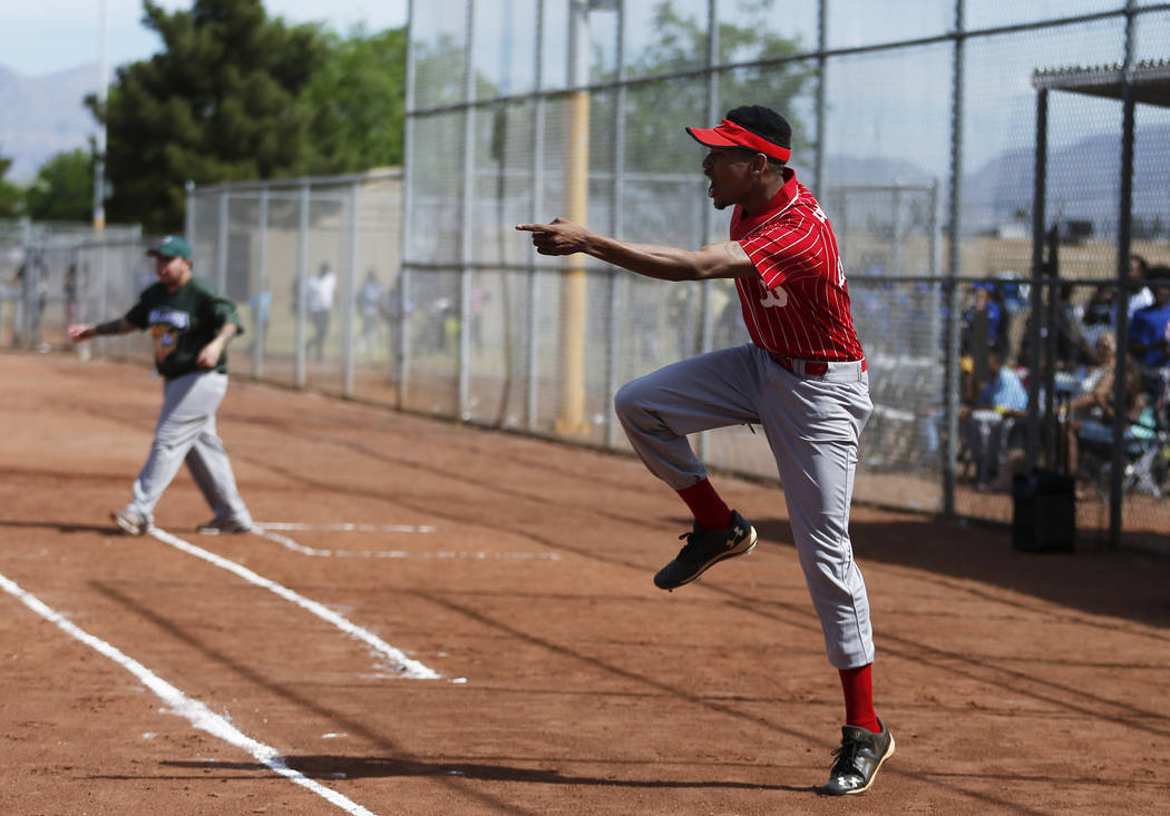 Las Vegas Fire Department Engine 106 Red Soxcoach DeShaun Lewis, 22, cheers on his team during a run against The Bulldogs at the Bolden Little League's Opening Day at Doolittle Field in Las  ...