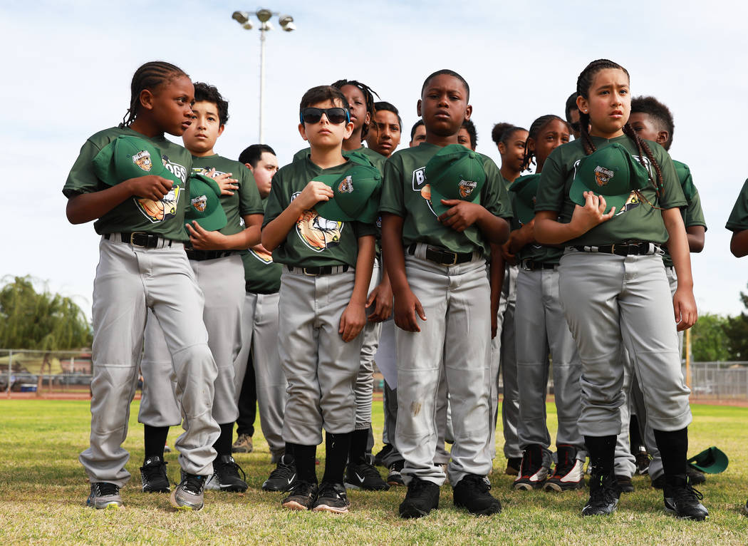 Marios West Side Bulldogs stand forPledge of Allegianceduring the Bolden Little League's Opening Day at Doolittle Field in Las Vegas on Saturday, April 7, 2018. Andrea Cornejo Las Vega ...