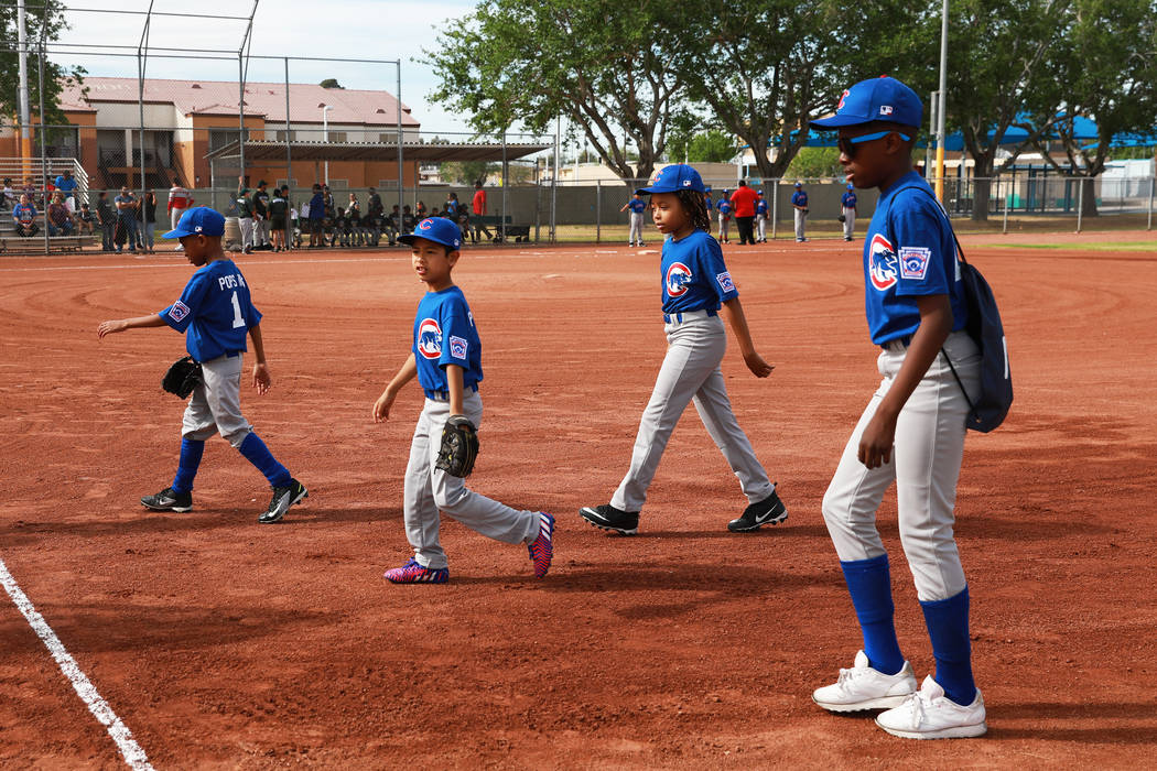 Cubs players exit the field during the Bolden Little League's Opening Day at Doolittle Field in Las Vegas on Saturday, April 7, 2018. Andrea Cornejo Las Vegas Review-Journal @dreacornejo