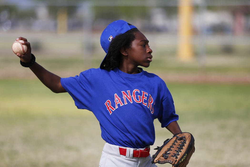 Rangers' Keshawn Estes, 11, practices with his team during the Bolden Little League's Opening Day at Doolittle Field in Las Vegas on Saturday, April 7, 2018. Andrea Cornejo Las Vegas Review-Journa ...