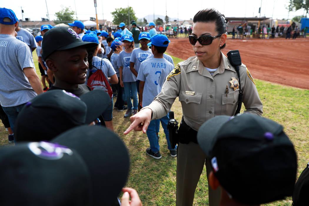 Yasenia Yatomi, bureau commander of Bolden Area Command, greets children during the Bolden Little League's Opening Day at Doolittle Field in Las Vegas on Saturday, April 7, 2018. Andrea Cornejo La ...