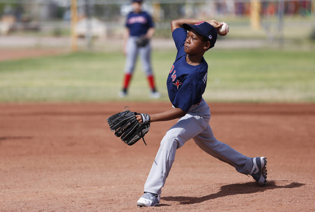 Las Vegas Fire Department Engine 106 Red Soxpitcher Jamarion Lewis pitches against The Bulldogs during the Bolden Little League's Opening Day at Doolittle Field in Las Vegas on Saturday, Apr ...