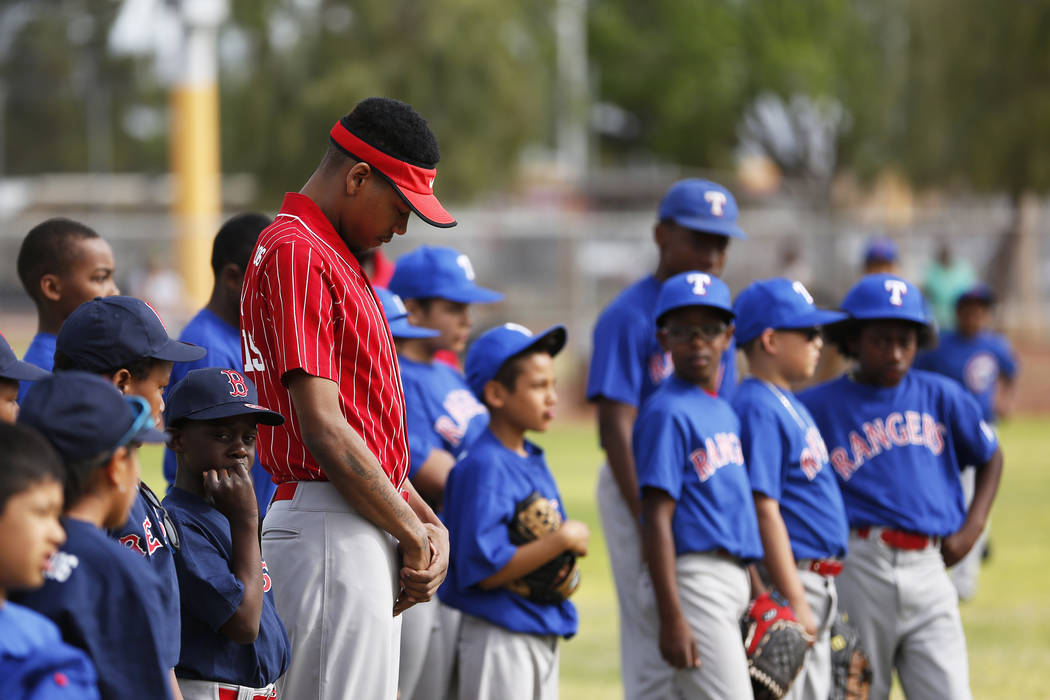 Las Vegas Fire Department Engine 106 Red Soxcoach DeShaun Lewis, 22, attends the Bolden Little League's Opening Day at Doolittle Field in Las Vegas on Saturday, April 7, 2018. Andrea Cornejo ...