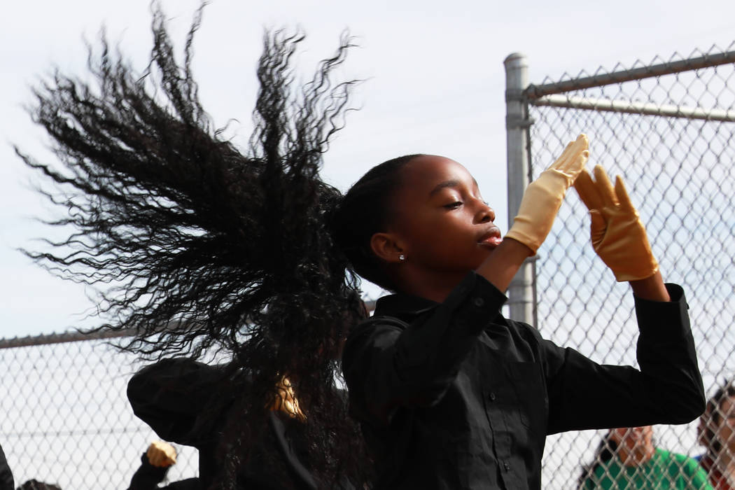 Kaykay, a dancer with the Las Vegas High Steppers, performs with her group during the Bolden Little League's Opening Day at Doolittle Field in Las Vegas on Saturday, April 7, 2018. Andrea Cornejo  ...