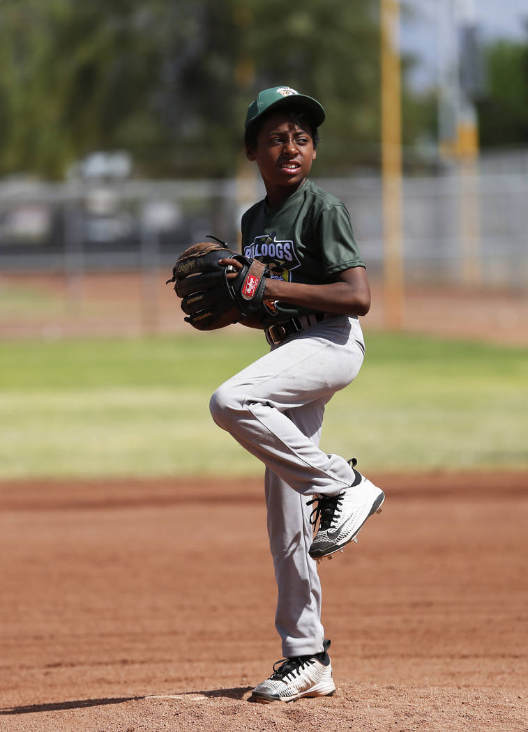 Marios West Side Bulldogs' pitcher Anthony Banisto pitches against the Las Vegas Fire Department Engine 106 Red Soxduring the Bolden Little League's Opening Day at Doolittle Field in Las Veg ...