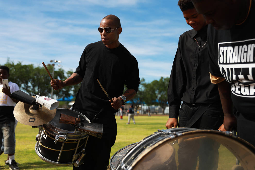 Vernon Jackson, 45, plays snare for the Las Vegas High Steppers' performance during the Bolden Little League's Opening Day at Doolittle Field in Las Vegas on Saturday, April 7, 2018. Andrea Cornej ...