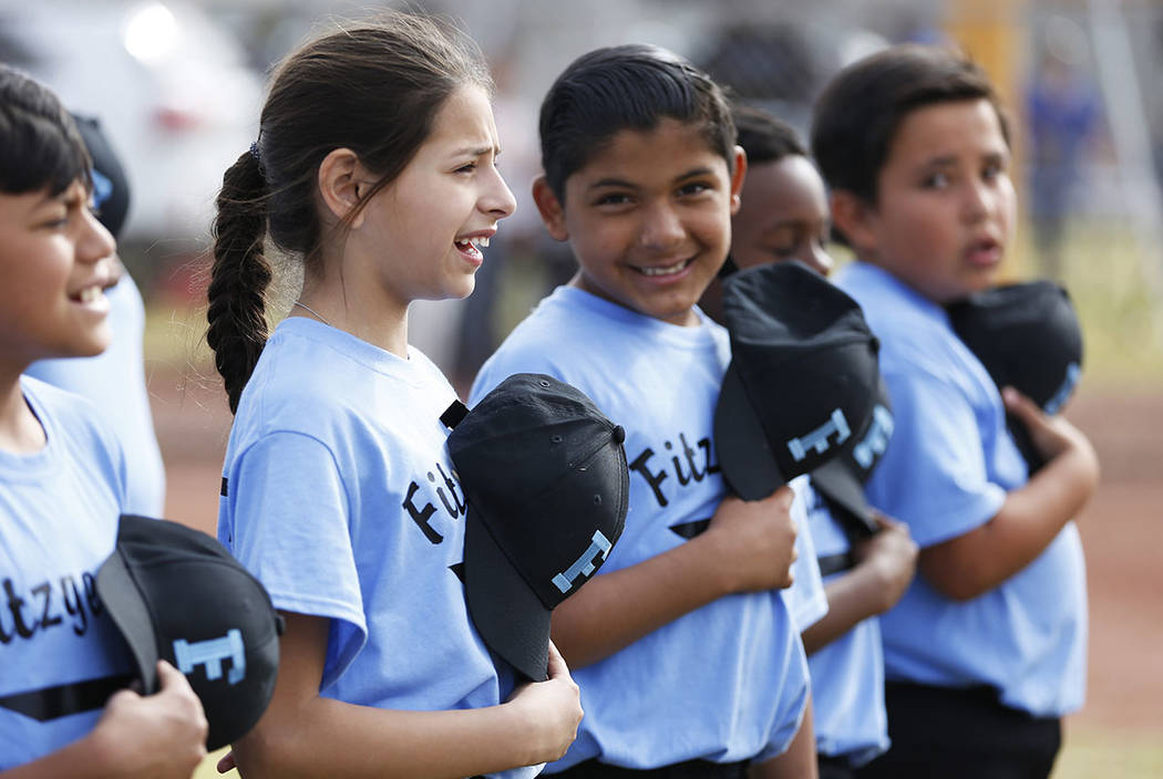 Airam Cruz, 10, stands forPledge of Allegianceduring the Bolden Little League's Opening Day at Doolittle Field in Las Vegas on Saturday, April 7, 2018. Andrea Cornejo Las Vegas Review- ...