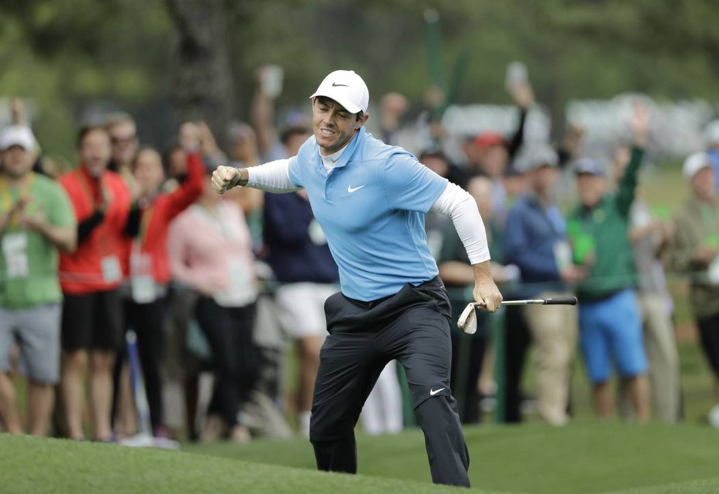 Rory McIlroy, of Northern Ireland, reacts after his eagle on the eighth hole during the third round at the Masters golf tournament Saturday, April 7, 2018, in Augusta, Ga. (AP Photo/David J. Phillip)