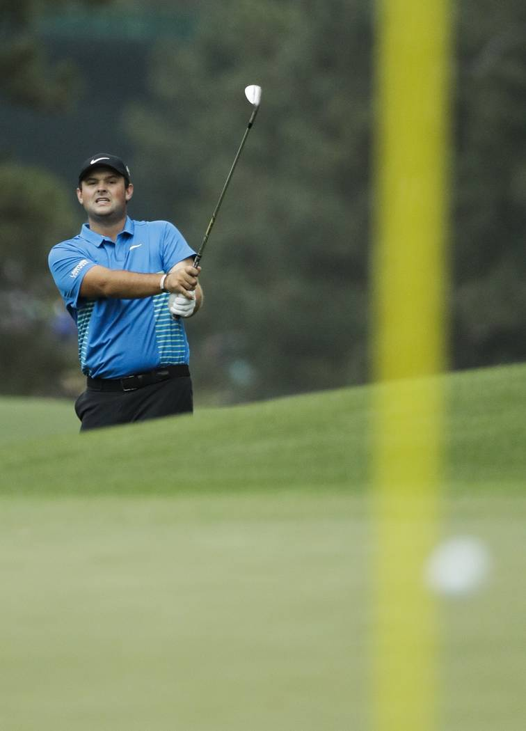 Patrick Reed hits to the eighth green during the third round at the Masters golf tournament Saturday, April 7, 2018, in Augusta, Ga. (AP Photo/David J. Phillip)