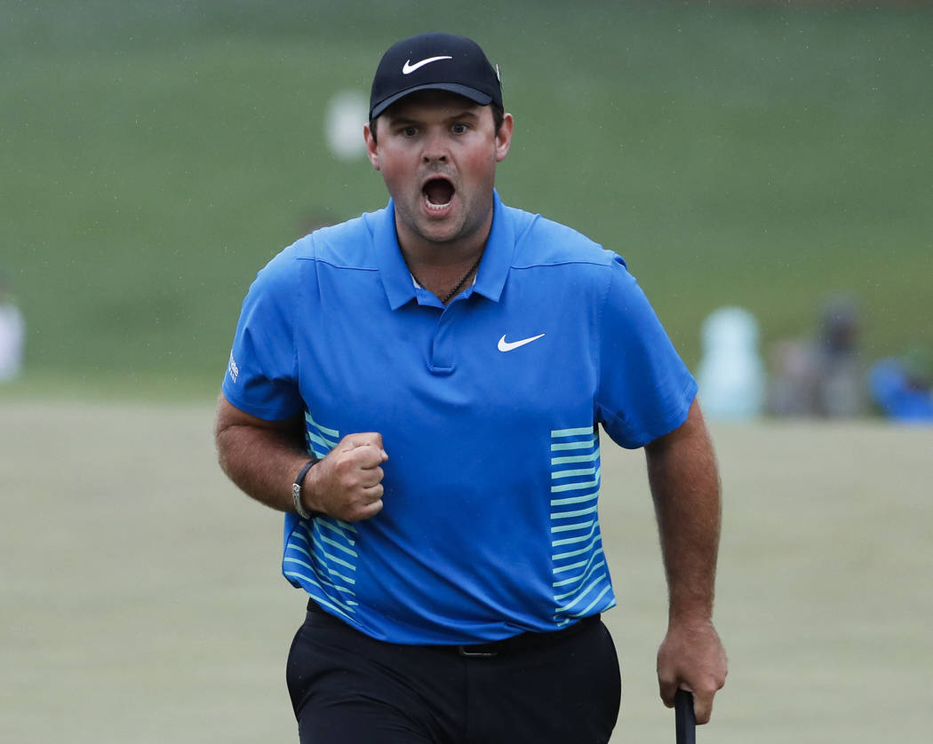 Patrick Reed reacts after making a birdie putt on the ninth hole during the third round at the Masters golf tournament Saturday, April 7, 2018, in Augusta, Ga. (AP Photo/David Goldman)