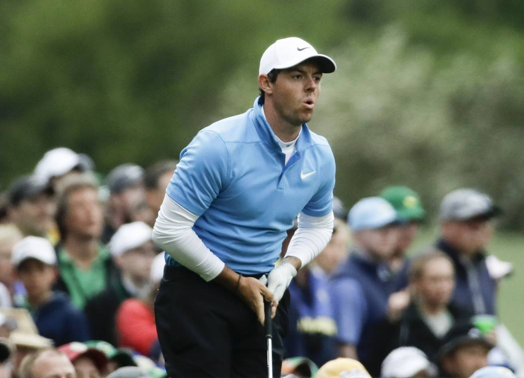 Rory McIlroy, of Northern Ireland, watches his shot on the 12th hole during the third round at the Masters golf tournament Saturday, April 7, 2018, in Augusta, Ga. (AP Photo/Chris Carlson)
